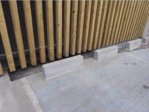 Petit génie civil : plots béton pour places de parking